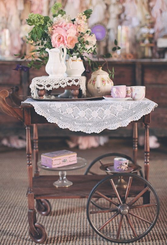 crochet tablecloth and doilies, vintage tableware and flowers