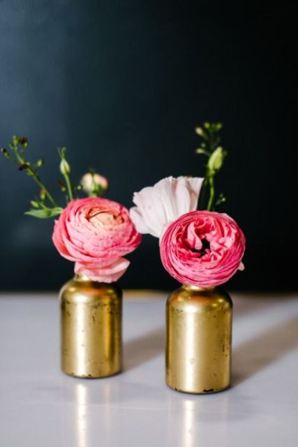 gilded bottle vases with bold flowers work as great decorations and centerpeices