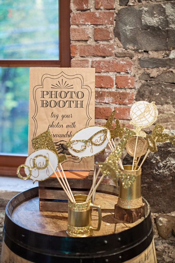 gilded photo booth props for a glam party