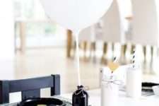 07 black and white table setting for a romantic occasion