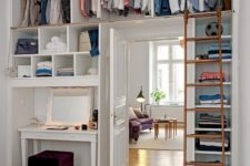 07 ceiling storage compartments for clothes and a ladder to get them