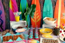 07 colorful dessert table with a surf boards backdrop