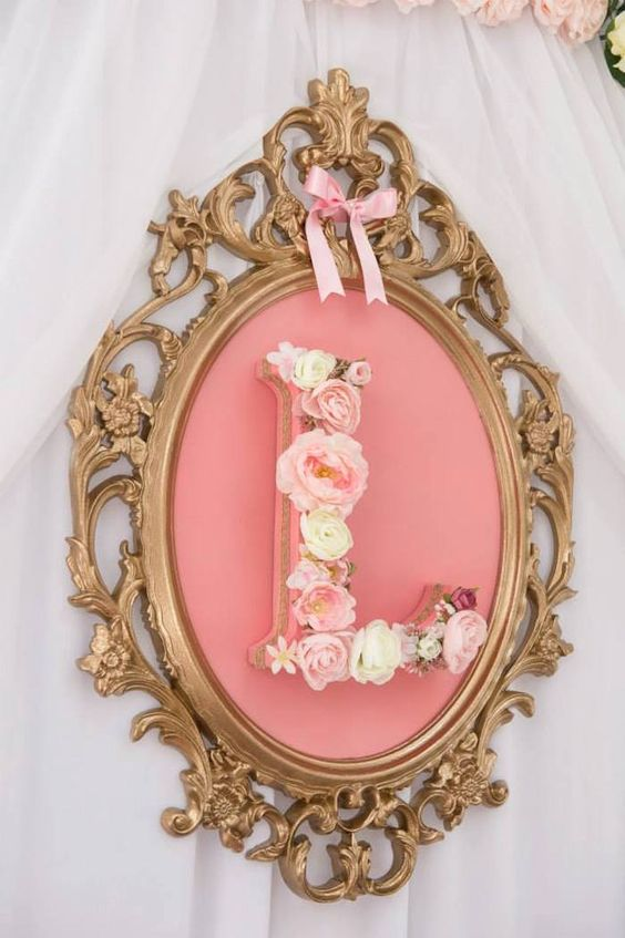 framed floral monogram of the girl's name