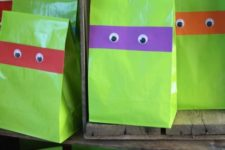 07 make your own paper favor bags using green paper and googly eyes