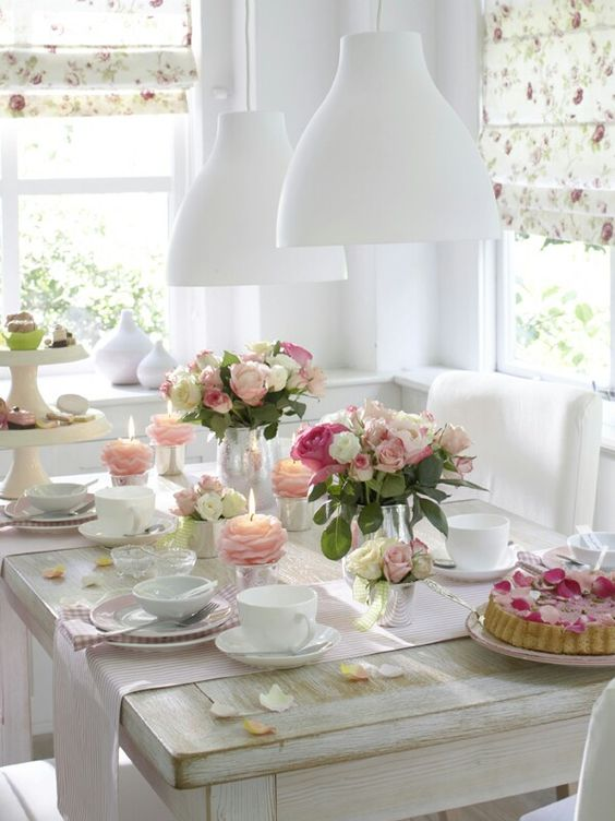 modern girlish tea party table decor with pink touches and a rose petal cake