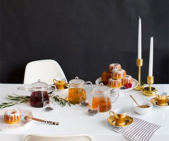 modern laconic tea party table setting with candles