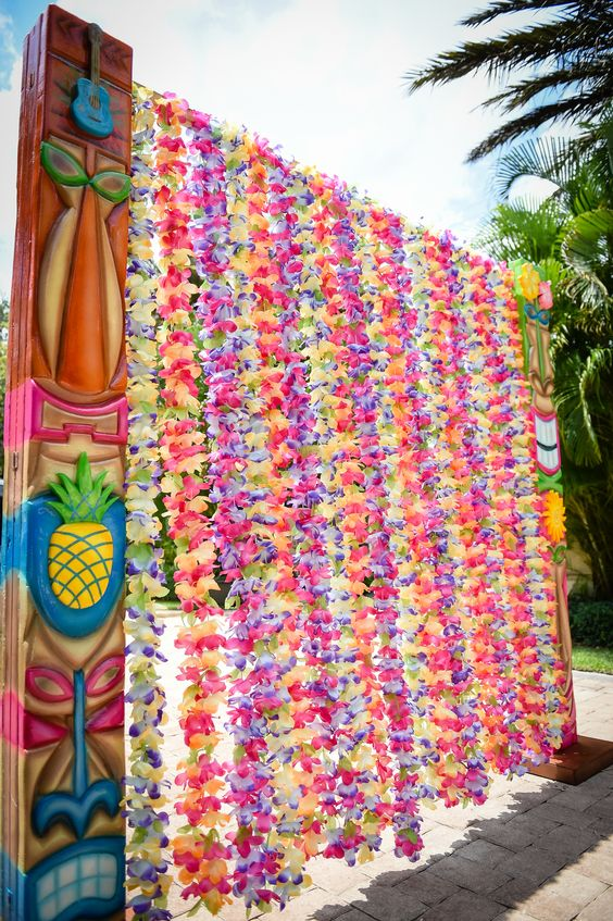 colorful luau entrance with bold paper flower garlands