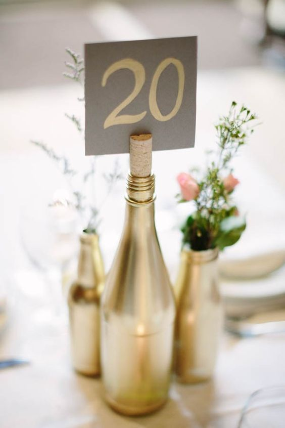 28 wine bottle centerpieces for every occasion shelterness for Painted wine bottle wedding centerpieces