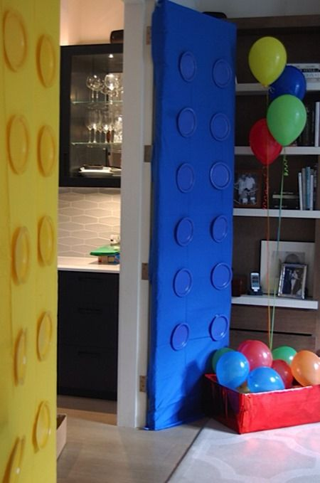 turn your doors into giant Legos with disposable table cloths and matching paper plates