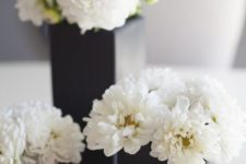 10 black vases with white flowers for decor and centerpieces