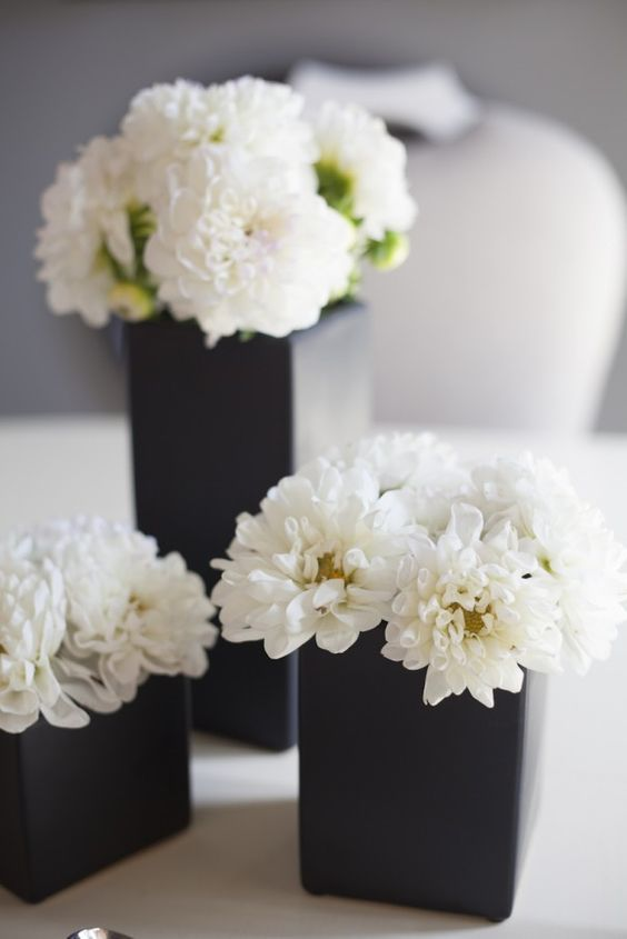 black vases with white flowers for decor and centerpieces