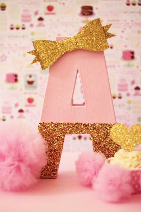 pink and gold letter decor with a bow