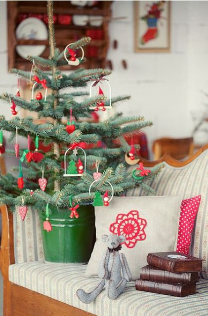 green and red ornaments and a green bucket for traditional and rustic decor
