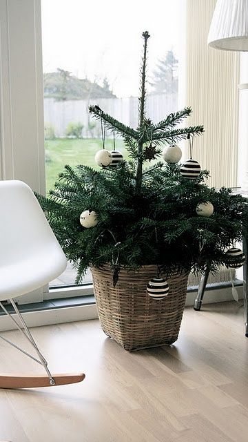 minimalist Christmas tree in a basket, black and white ornaments