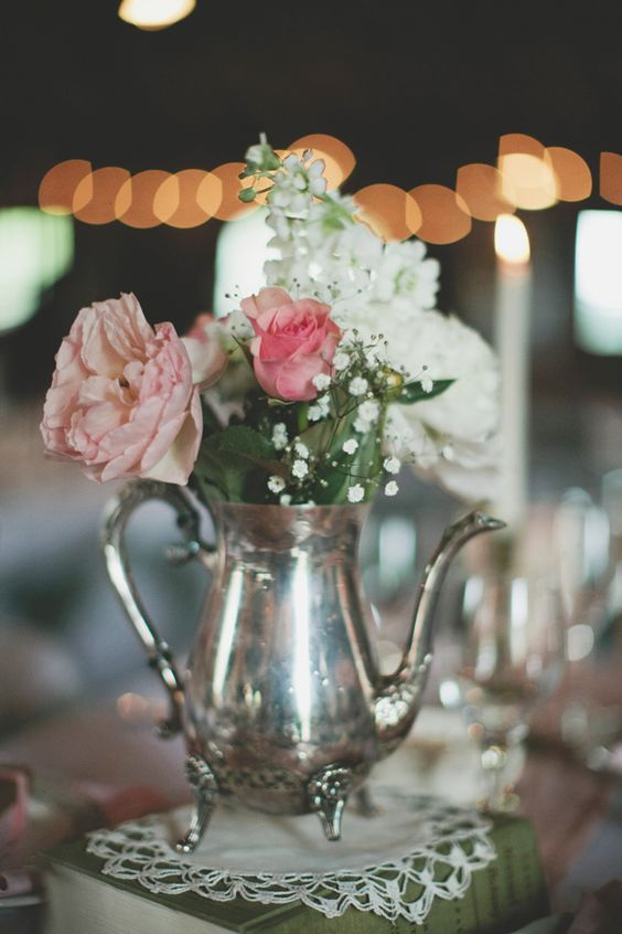 silver tea pot as a vase for flowers