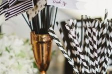 12 striped straws and drink stirrers