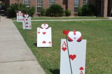 13 instead of balloons, oversized playing cards lining driveway for Alice In Wonderland party