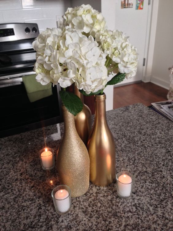 paint some bottles with gold, and other with glitter gold and add white flowers