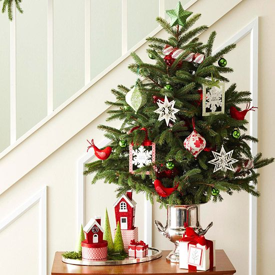 Small Tree By The Stairs With Tiny Ornaments, Bold Red Birds And Paper  Decorations
