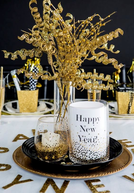 try coupling glimmering golds with bright whites and bursts of black for a standout tablescape