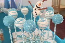 14 cake pops displayed on a cardboard snowflake