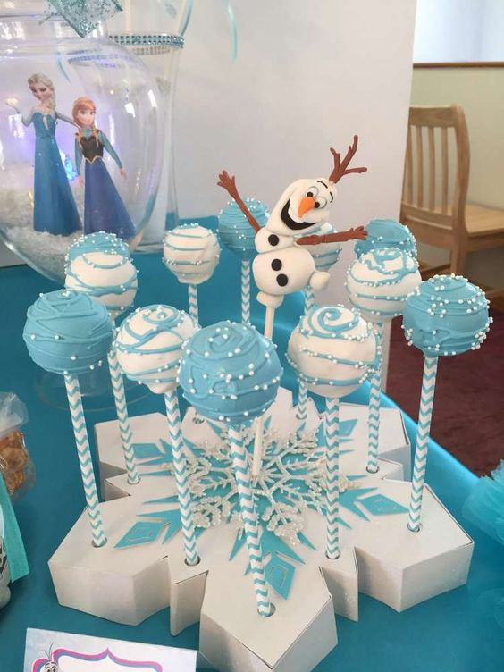 cake pops displayed on a cardboard snowflake