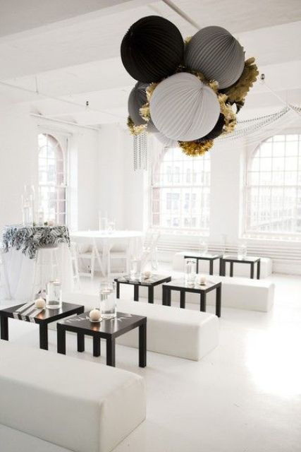 monochrome space with paper decorations hanging from the ceiling