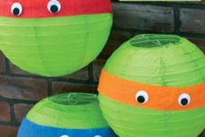 14 wrap bands of colored crepe paper around paper lanterns, and adds on some googly eyes