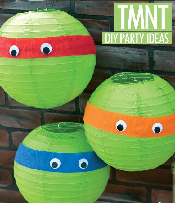 wrap bands of colored crepe paper around paper lanterns, and adds on some googly eyes