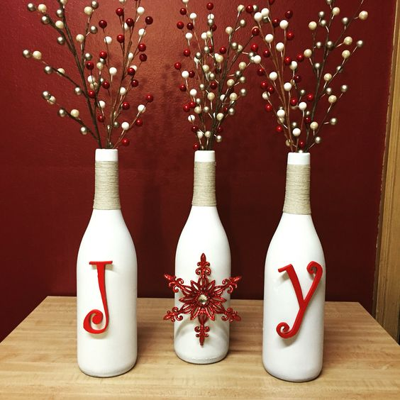 holiday centerpiece with white bottles, yarn and red letters