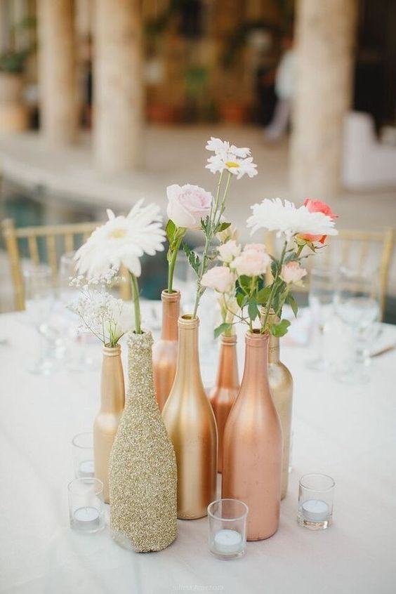 gold, glitter and copper centerpiece with fresh flowers