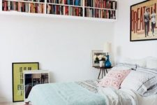 17 ceiling bookshelves will save some floor space