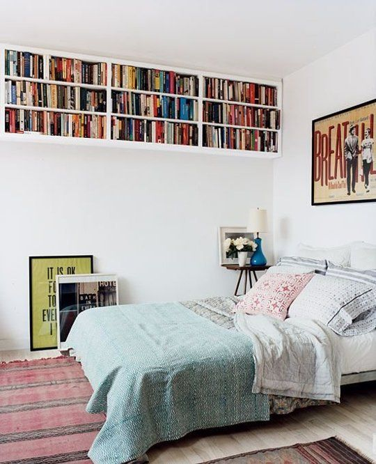 ceiling bookshelves will save some floor space