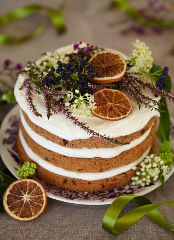 chic winter cake with citrus and winter flowers
