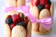 17 lady fingers, filled with mousse, topped with fresh berries and tied with a bow