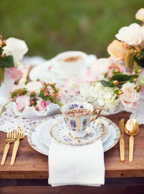vintage tea cups, fresh pastel flowers