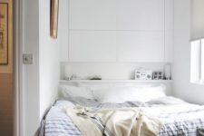 18 headboard wall drawers and an open shelf behind the bed