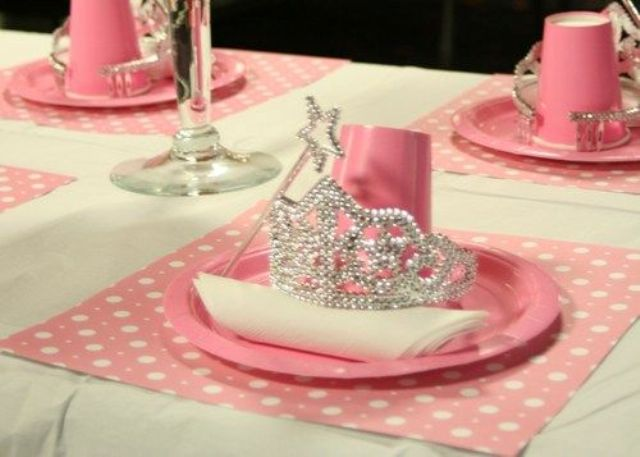 pink table setting with a wand and a tiara