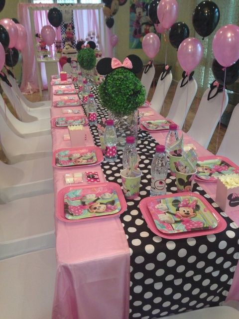 pink and polka dot table setting with balloons