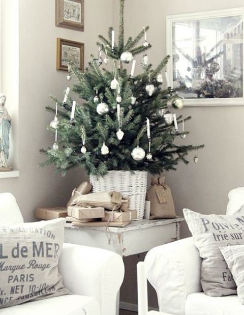 tiny tree in a white basket, white ornaments