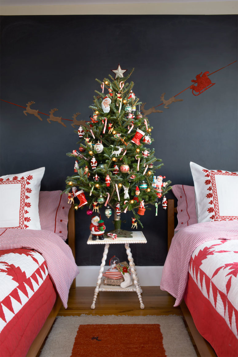 a small tree decorated with colorful ornaments is a great idea for a kids room