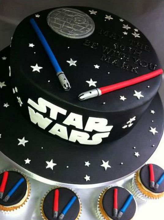 chic black Star Wars cake topped with light sabers