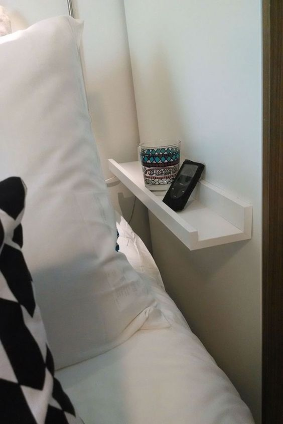 small wall-mounted nightstand