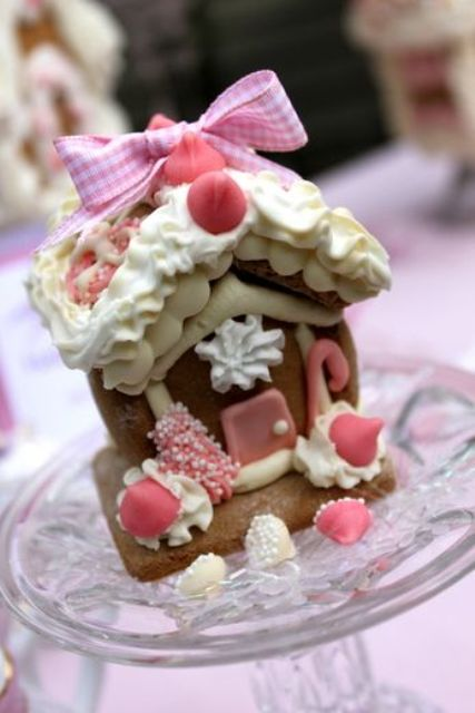 pink gingerbread house for a holiday tea party