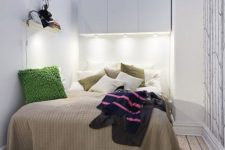 22 storage cabinets with light above the bed