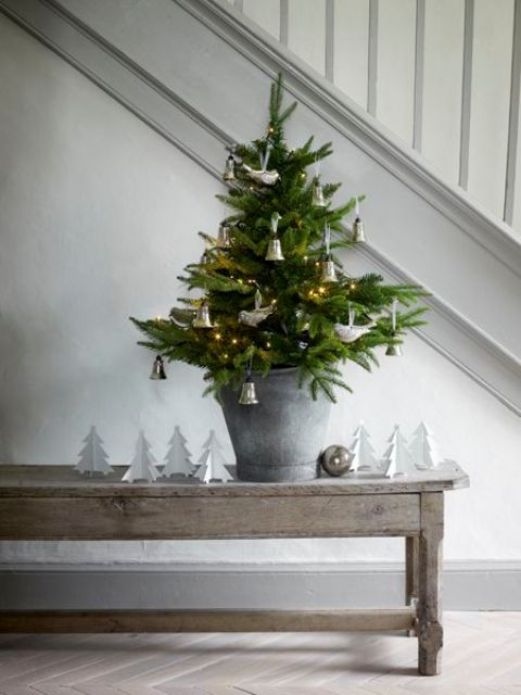 fir tree in a galvanized bucket, bells and bird ornaments