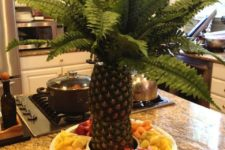 23 fruit platter with pineapples in the center