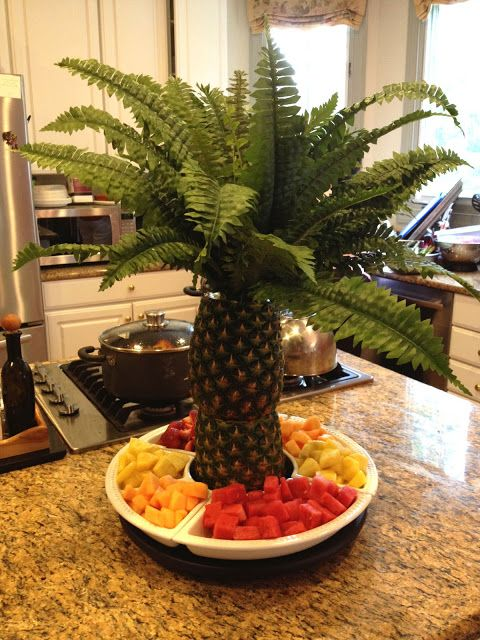 fruit platter with pineapples in the center