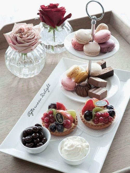 tarts, macarons servedon simple white tableware