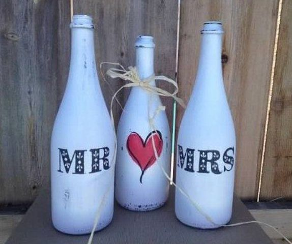 whitewashed wine bottle centerpiece for a wedding